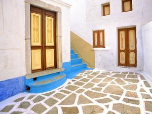 Greece, Symi. Doors to courtyard and stairway of house. by Jaynes Gallery