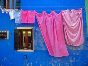 Italy, Burano. Drying laundry and colorful window and wall. by Jaynes Gallery