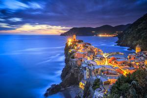 Italy, Vernazza. Overview of coastal town at sunset. by Jaynes Gallery
