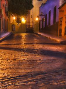 Mexico, San Miguel De Allende. Lanterns Reflect on Cobblestone Street by Jaynes Gallery