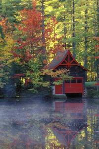 New York, Adirondack Mountains. Boathouse in Autumn Along the Lake by Jaynes Gallery