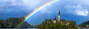 Slovenia. Rainbow over Lake Bled at sunset. by Jaynes Gallery
