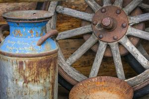 USA, Alaska. Antique milk can, wagon wheel and gold pan. by Jaynes Gallery
