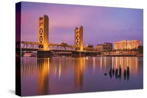 USA, California, Sacramento. Sacramento River and Tower Bridge at sunset. by Jaynes Gallery