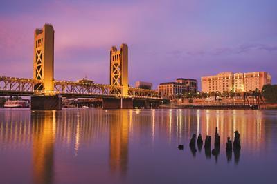 USA, California, Sacramento. Sacramento River and Tower Bridge at sunset.