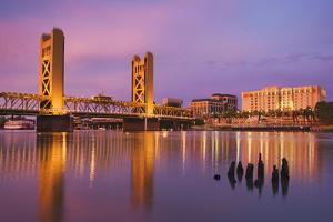 USA, California, Sacramento. Sacramento River and Tower Bridge at sunset. by Jaynes Gallery