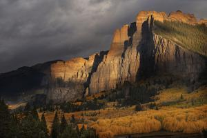 USA, Colorado, Gunnison National Forest. The Castles rock formation on a stormy autumn sunrise. by Jaynes Gallery