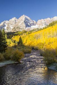 USA, Colorado, Maroon Bells. Mountain and stream in autumn forest. by Jaynes Gallery