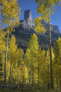 USA, Colorado, San Juan Mountains. Autumn aspen trees frame Chimney Rock. by Jaynes Gallery