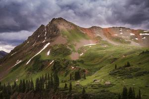 USA, Colorado, San Juan Mountains. Green mountain tundra and summer storm clouds. by Jaynes Gallery