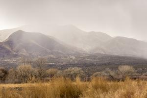 USA, New Mexico, Bosque del Apache National Wildlife Refuge. Storm over mountains and valley. by Jaynes Gallery