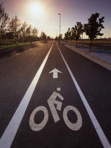 Usa, Oregon, Portland. Bike rider sign on street. by Jaynes Gallery