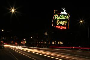USA, Oregon, Portland. Neon sign in Old Town and traffic blur. by Jaynes Gallery