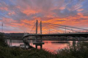 USA, Oregon, Portland. Tilikum Bridge Crossing and Willamette River at sunset. by Jaynes Gallery