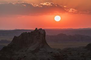 USA, South Dakota, Badlands National Park. Sunset over eroded formations. by Jaynes Gallery