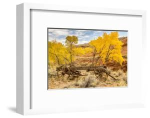 USA, Utah, Capitol Reef National Park. Old wagon and mountain and trees in autumn. by Jaynes Gallery
