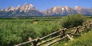 USA, Wyoming, Grand Teton National Park. Split-rail fence and mountain landscape. by Jaynes Gallery