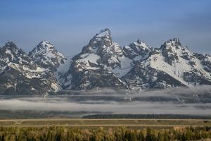 USA, Wyoming, Grand Teton NP. Morning fog and mountains. by Jaynes Gallery