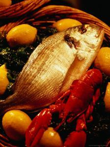 Fish and Lobster on Bed of Green Vegetables and Lemons, Marseille, France by Jean-Bernard Carillet