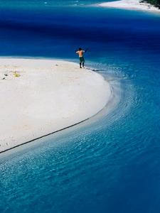 Man Fishing in Lagoon, New Caledonia by Jean-Bernard Carillet