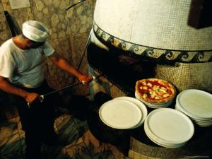 Pizzaiolo at Work at Pizzeria Trianon by Jean-Bernard Carillet