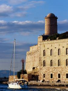 Sail Boat Passing Fort Saint-Jean, Marseille, France by Jean-Bernard Carillet