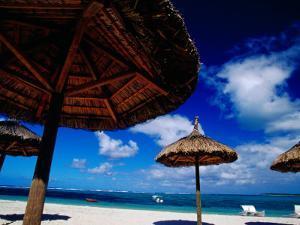 Thatched Umbrellas on an Beach, Trou d'Eau Douce, Mauritius by Jean-Bernard Carillet