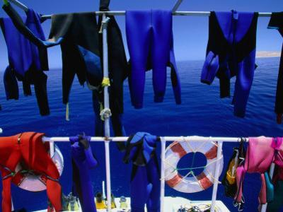 "Wetsuits Drying on ""Live-Aboard"" Dive Boat in Straits of Gubal, Egypt"