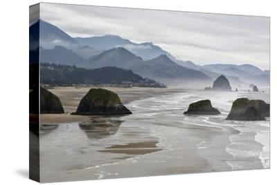 USA, Oregon, Cannon Beach. Fog Rises over Coastline at Low Tide