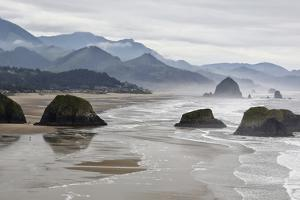 USA, Oregon, Cannon Beach. Fog Rises over Coastline at Low Tide by Jean Carter