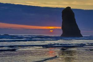 USA, Oregon, Cannon Beach. Sunset on Lone Seastack by Jean Carter