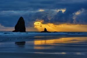 USA, Oregon, Cannon Beach. Sunset on Needles Seastack by Jean Carter