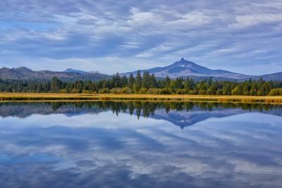 USA, Oregon. Clouds Reflect in Small Lake at Black Butte Ranch