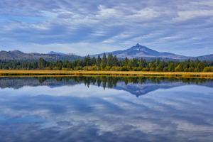 USA, Oregon. Clouds Reflect in Small Lake at Black Butte Ranch by Jean Carter