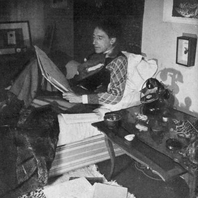 Jean Cocteau French Writer, Artist and Film Maker, Reading in Bed in 1941--Photographic Print
