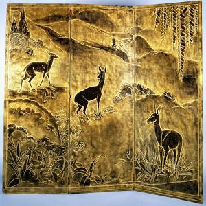 A Three-Fold Lacquer Screen, Depicting Deer in a Landscape of Hills by Jean Dunand