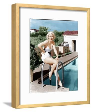 Jean Harlow poses in front of her home at 1353 Club View Drive, Beverly Hills, California, ca. 1933