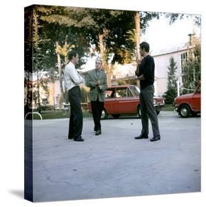Jean-Paul Belmondo, Rene Clement and Alain Delon on set of film 'Is Paris burning?', 1966 (photo)
