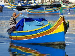 Fishing Boat in Marsaxlokk Harbour by Jean-pierre Lescourret