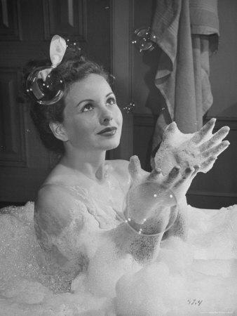 https://imgc.artprintimages.com/img/print/jeanne-crain-taking-bubble-bath-for-her-role-in-movie-margie_u-l-p472ue0.jpg?p=0