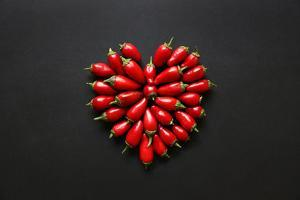 Red Jalapeno Peppers in a Heart Shape by Jeanninemcchesney