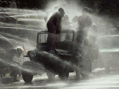 Jeep Full of Innocent Onlookers is Sprayed with Water During the Water Festival-James L^ Stanfield-Photographic Print