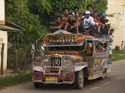 https://imgc.artprintimages.com/img/print/jeepney-truck-with-passengers-crowded-on-roof-coron-town-busuanga-island-philippines_u-l-p7r08a0.jpg?p=0