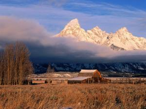 View of Historic Old Barn and Snow-Covered Teton Mountain Range by Jeff Foott