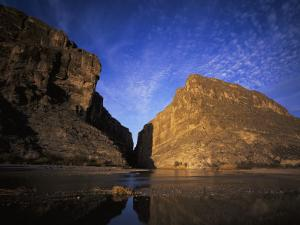 View of Santa Elena Canyon at Sunrise and its Reflection in Rio Grande River by Jeff Foott