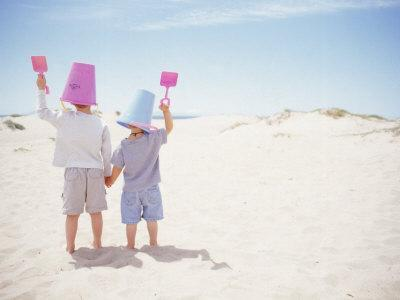 2 Boys with Sand Bucket Over Their Heads