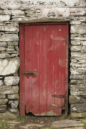 A Red Door in a Stone House in County Kerry, Ireland