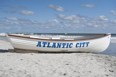 A Rowboat Sits on the Beach in Atlantic City, New Jersey by Jeff Mauritzen