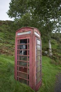Red Telephone Booth on Kerrera Isle, Part of the Scottish Inner Hebrides by Jeff Mauritzen