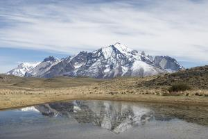 Reflection of Mountains at Torres Del Paine National Park by Jeff Mauritzen